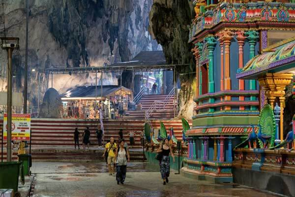 Visit the Temple in Batu Caves with Fortune Connect Holidays , Worship Lord Murugan, Its a Limstone